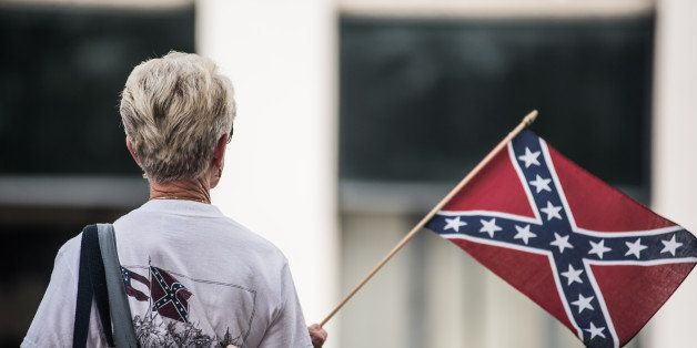 COLUMBIA, SC - JULY 8:  A woman shows her support for the Confederate battle flag at the South Carolina state house July 8, 2