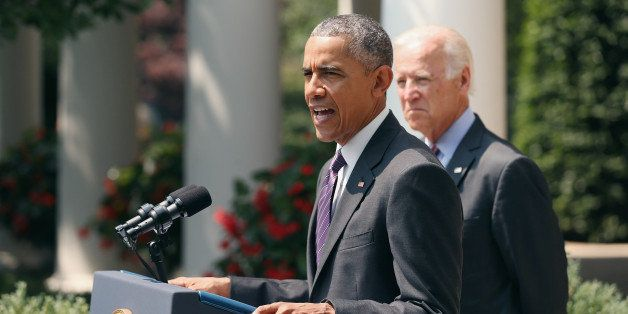 WASHINGTON, DC - JULY 01: U.S. Vice President Joe Biden (R) looks on as U.S. President Barack Obama speaks at a press confere