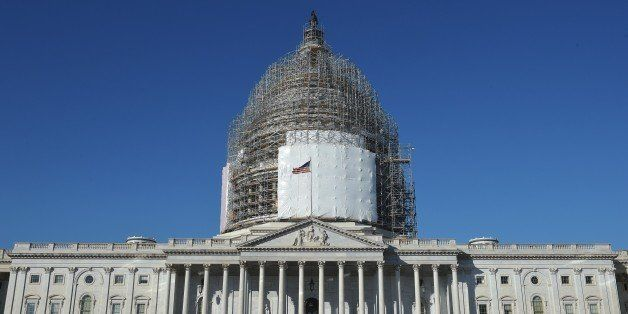 A February 11, 2015 photo shows the US Capitol with its dome encased in scaffolding as it undergoes renovation in Washington,