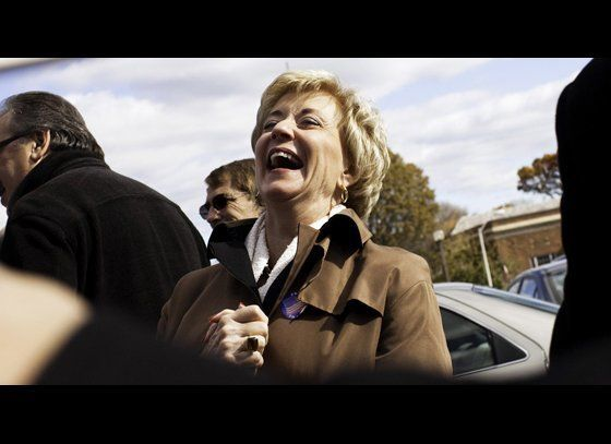 Republican U.S. Senate candidate Linda McMahon laughs while greeting supporters outside Harborside Middle School November 2,