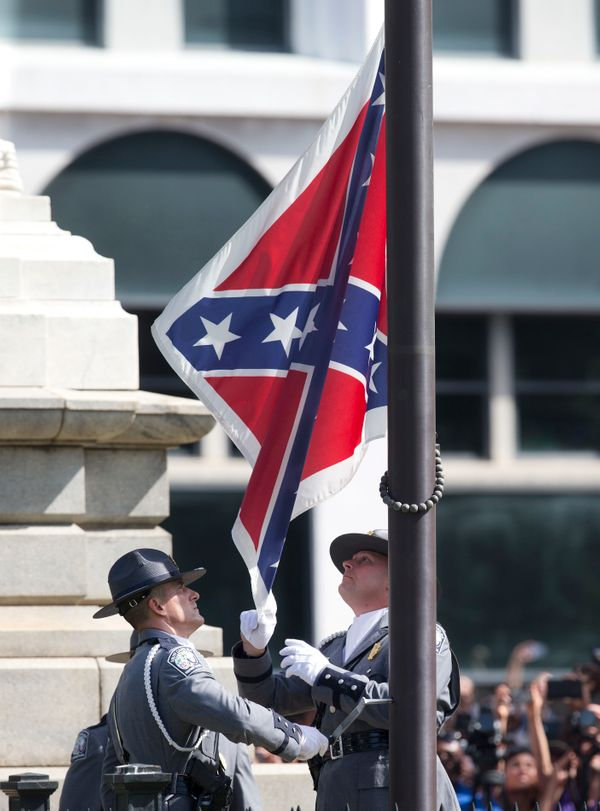 An honor guard from the South Carolina Highway patrol removes the Confederate battle flag from the Capitol grounds in Columbi