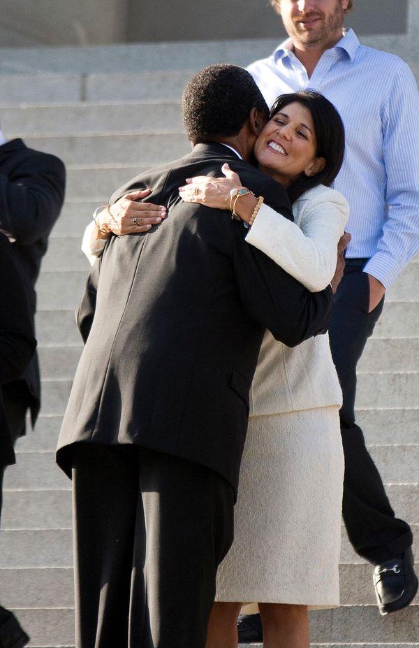South Carolina Gov. Nikki Haley hugs Rev. Norvel Goff, interim pastor at Emanuel AME Church in Charleston, before an honor gu