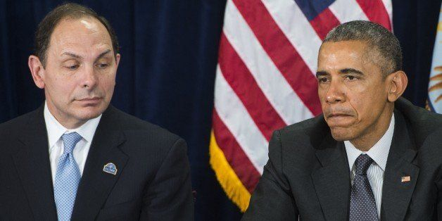 US President Barack Obama speaks alongside Secretary of Veterans Affairs Robert McDonald (L) following a briefing on US milit