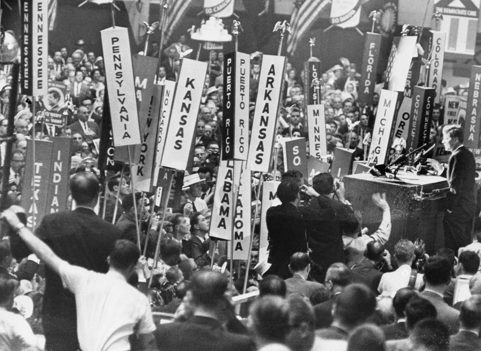 Presidential candidate John F. Kennedy stands before the crowds at the Democratic National Convention on July 14, 1960, in Lo