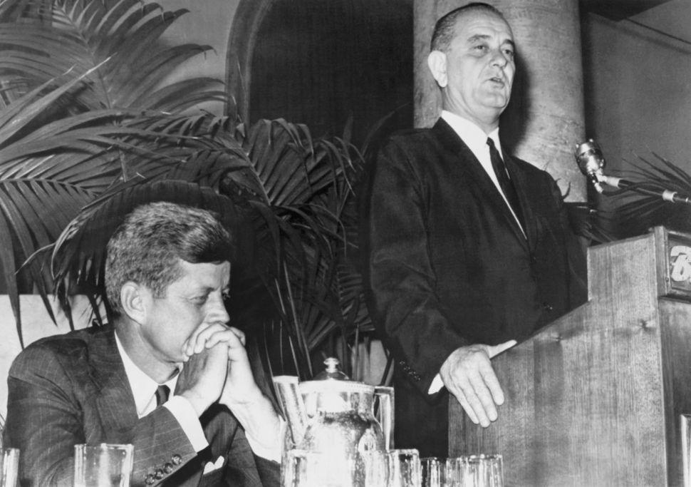 Democratic Presidential nominee Sen John Kennedy listens as his running mate, Sen Lyndon Johnson, assures a group of black de