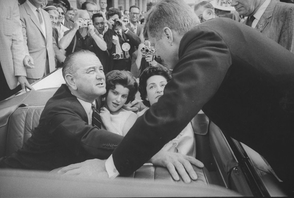 American politicians and Democratic hopefuls for the White House, Sens. Lyndon B. Johnson (left, seated) and John F. Kennedy