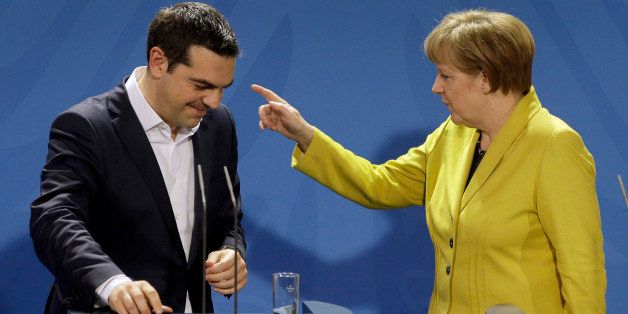 German Chancellor Angela Merkel, right, points as she and the Prime Minister of Greece Alexis Tsipras leave after a press con