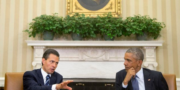 President Barack Obama hosts a bilateral meeting with Mexican President Enrique Pena Nieto, Tuesday, Jan. 6, 2015, in the Ova
