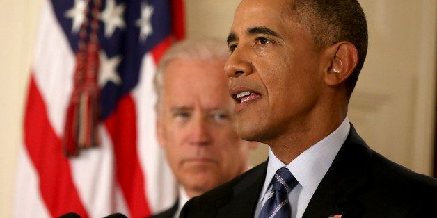 WASHINGTON, DC - JULY 14:  President Barack Obama, standing with Vice President Joe Biden, conducts a press conference  in th