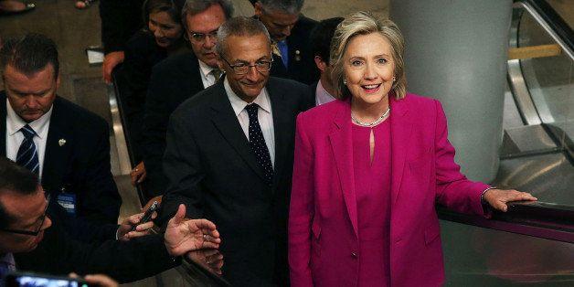 WASHINGTON, DC - JULY 14:  Democratic U.S. presidential hopeful and former U.S. Secretary of State Hillary Clinton rides anÊ