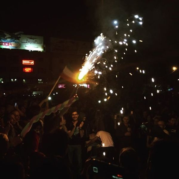 People celebrate in Tehran on Tuesday, July 14, 2015.