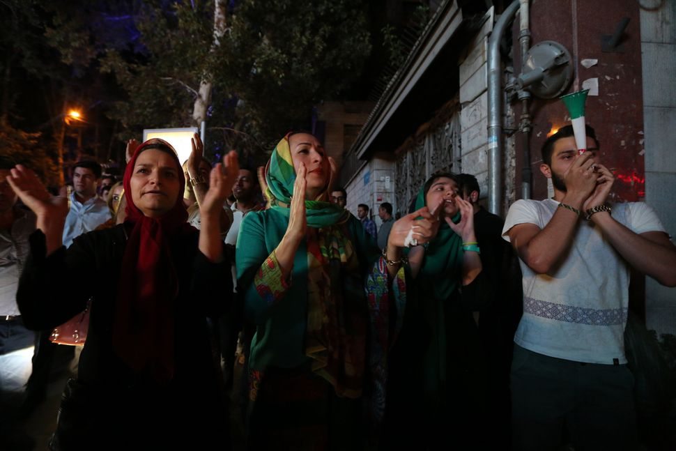 Iranians gather in celebration in northern Tehran on July 14, 2015, after Iran's nuclear negotiating team struck a deal with