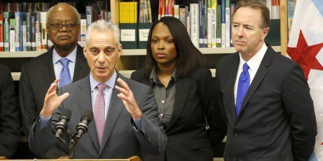 Chicago mayor Rahm Emanuel, second from left, responds to a question about the Chicago Public Schools after announcing a news