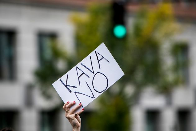 A protestor holds up an anti-Kavanaugh sign