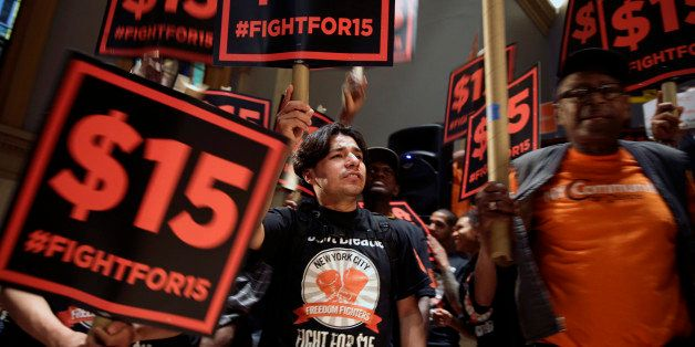 FILE - In this June 15, 2015, file photo, demonstrators rally for a $15 minimum wage before a meeting of the state Wage Board