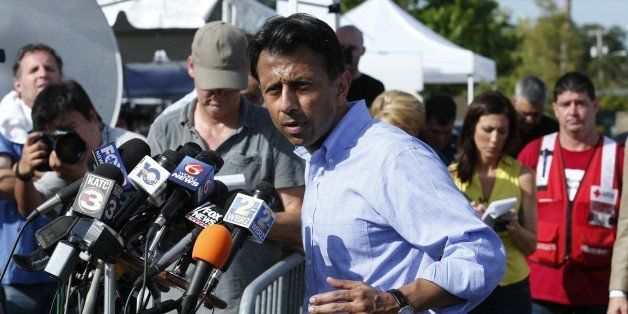 Louisiana Governor Bobby Jindal talks to the media after observing the crime scene inside The Grand Theatre following the pre