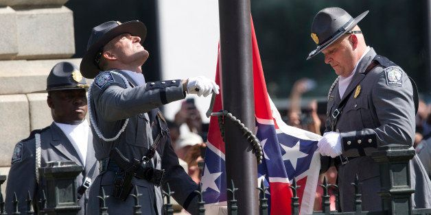 An honor guard from the South Carolina Highway patrol removes the Confederate battle flag from the Capitol grounds Friday, Ju