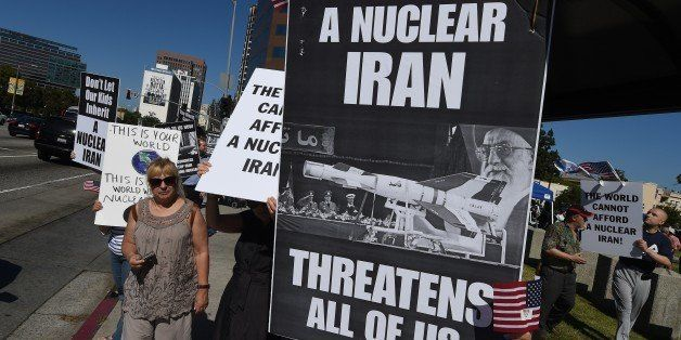 Members of the 'Stand With Us' group hold a rally calling for the rejection of the proposed Iran nuclear deal outside the Fed
