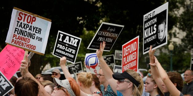 WASHINGTON, DC - JULY 28: Anti-abortion activists hold a rally opposing federal funding for Planned Parenthood in front of th