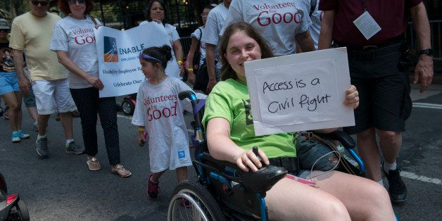 NEW YORK, NY - JULY 12: People participate in the first annual Disability Pride Parade on July 12, 2015 in New York City. The