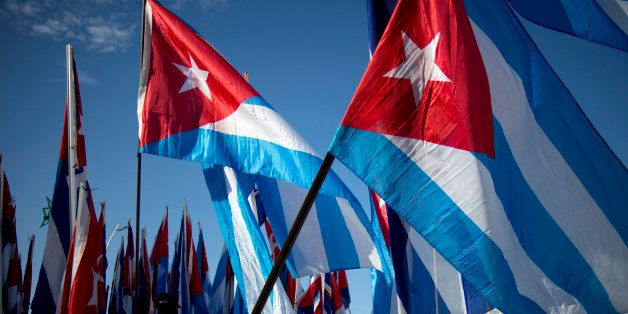 Students march carrying Cuban flags during a march against terrorism in Havana, Cuba, Tuesday, Sept. 30, 2014. Youths marched