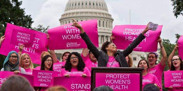 Cheered on by Carol McDonald from Planned Parenthood Federation of America, women rally on Capitol Hill in Washington, Thursd