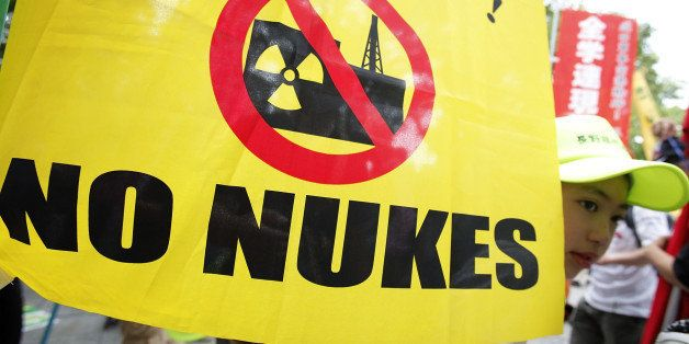 HIROSHIMA, JAPAN - AUGUST 06:  People take part in an anti-nuclear power protest on the 66th anniversary of the Hiroshima ato
