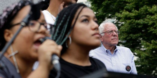 Marissa Johnson, left, speaks as Mara Jacqueline Willaford stands with her and Democratic presidential candidate Sen. Bernie