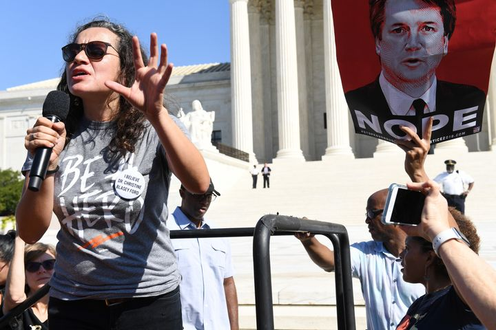 Ana Maria Archila addresses anti-Kavanaugh demonstrators outside the U.S. Supreme Court on Thursday.