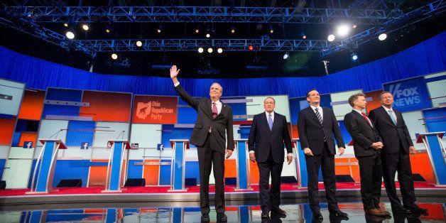Republican presidential candidates from left, former Florida Gov. Jeb Bush, former Arkansas Gov. Mike Huckabee, Sen. Ted Cruz