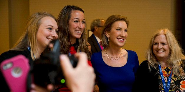 Republican presidential candidate Carly Fiorina poses for photographs, Friday, June 19, 2015, at the Northeast Republican Lea