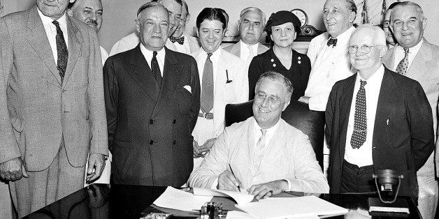 FLE - In this Aug. 14, 1935, file photo President Franklin Roosevelt signs the Social Security bill in Washington. Americans