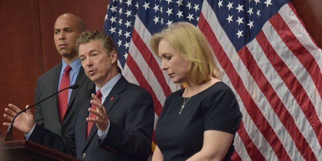 Senator Rand Paul , R-KY, speaks during a press conference with Senator Cory Booker, D-NJ, and Kirsten Gillibrand, D-NY, to a