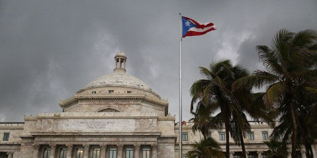 SAN JUAN, PUERTO RICO - JULY 01:  The Puerto Rican flag flies near the Capitol building as the island's residents deal with t