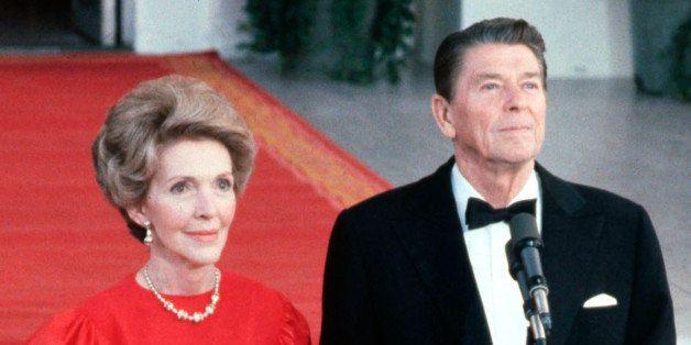 WASHINGTON - MAY 7:  (NO U.S. TABLOID SALES)  U.S. President Ronald Reagan and wife Nancy greeting the press at the North Por