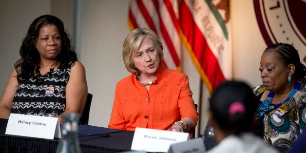 Democratic presidential candidate Hillary Rodham Clinton, center, speaks as she is joined by home care worker Regina Sutton,