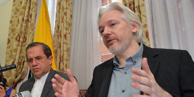 FILE - In this Aug. 18, 2014, file photo, Ecuador's Foreign Minister Ricardo Patino, left, and WikiLeaks founder Julian Assan