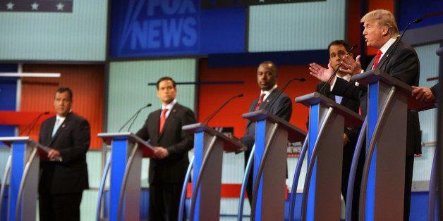 Republican presidential candidate Donald Trump speaks as  from left, Chris Christie, Marco Rubio, Ben Carson, Scott Walker li