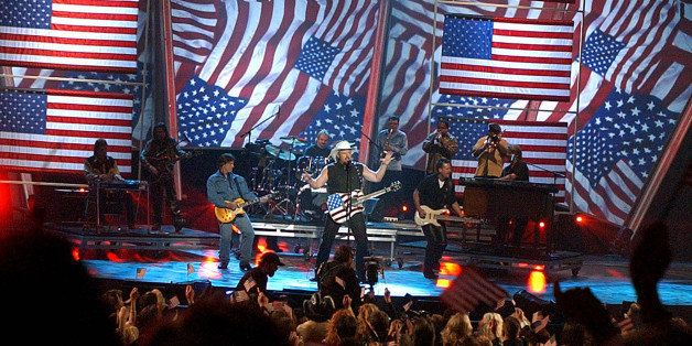 "Toby Keith, center, performs ""Courtesy of the Red, White & Blue"" at the 37th Annual Academy of Country Music Awards Wedne"
