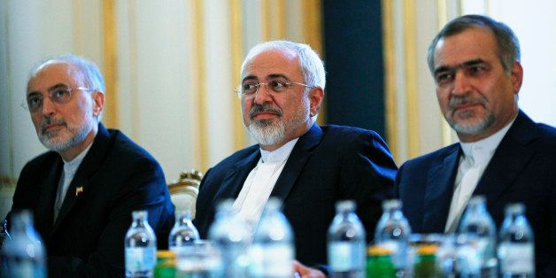 Iranian Foreign Minister Mohammad Javad Zarif, centre, Head of the Iranian Atomic Energy Organization Ali Akbar Salehi, left,