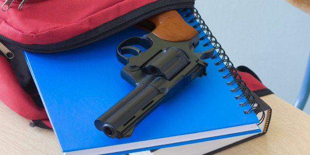 Backpack, notebooks, and handgun