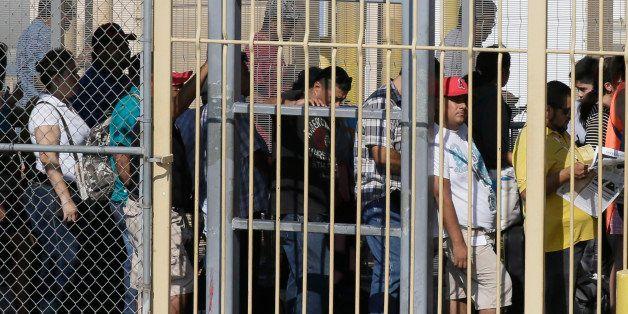 Pedestrians wait in line to enter the U.S. from Mexico in Laredo, Texas, across the Rio Grande from Nuevo Laredo, Tamaulipas,