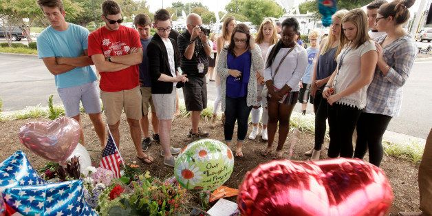 ROANOKE, VA - AUGUST 27: Mass communication students from the Burton Center come to pay their respects at a memorial at WDBJ