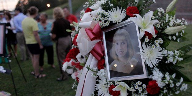 MARTINSVILLE, VA - AUGUST 27: A photo sits amonst flowers at a  candlelight vigil for Alison Parker on Martinsville High Scho