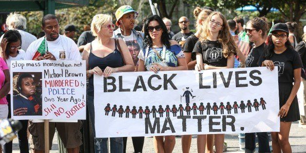 NEW YORK, NY - AUGUST 09: People hold banners reading 'Black Lives Matter' during a rally to mark the one year anniversary of