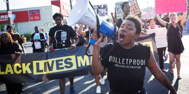 TORONTO, ON- JULY 27 - Pascale Diverlus yells into microphones during a Black Lives Matter protest that marched from Gilbert