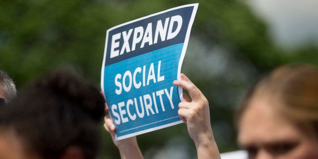An 'Expand Social Security' sign is held up during a news conference with Bill de Blasio, mayor of New York, not pictured, ou