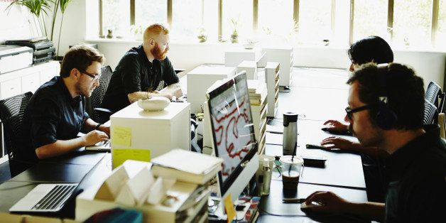 Businessmen and businesswoman working in startup office
