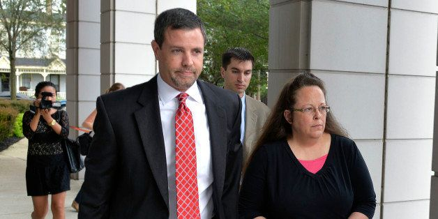 Rowan County Clerk Kim Davis, right, walks with her attorney Roger Gannam into the United States District Court for the Easte