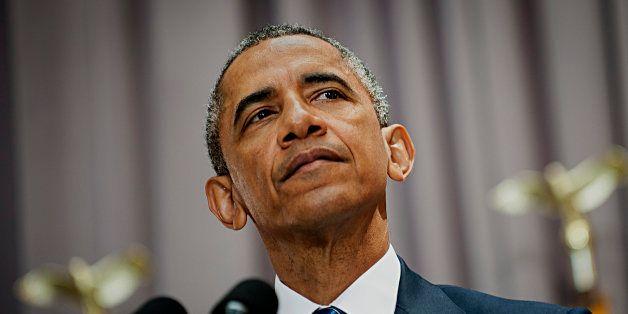 U.S. President Barack Obama pauses while speaking at American University's School of International Service in Washington, D.C